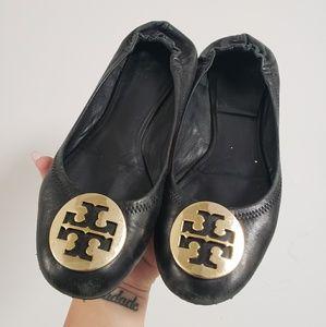 Tory Burch black flats with gold emblem